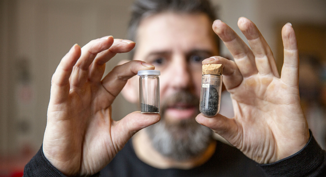 Professor Martin Bizzarro with two vials containing CI chondrites