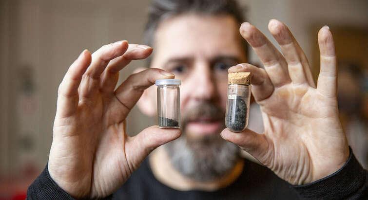 Professor Martin Bizzarro with two vials containing CI chondrites