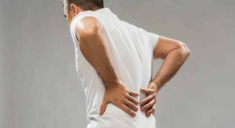 Man grabbing his back