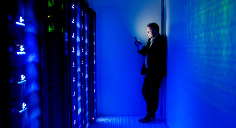 Søren Brunak in a dark server room